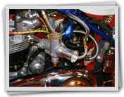 An AMAL GP Carburetter with and SU Float Chamber fitted to a 650cc Triumph